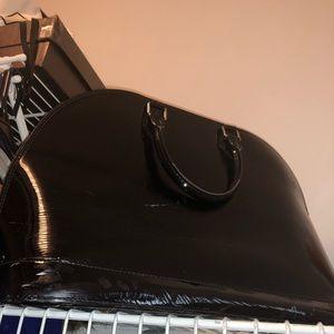 Luis Vuitton Alma Medium. No date in bag.